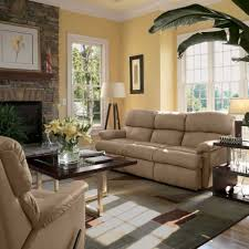 Living Room With A Fireplace Apartments Modern Cream Leather Sofa Sectional And Brick Stone