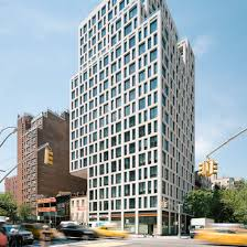 Luxury Manhattan apartment tower by S9 Architecture cantilevers over  low-rise neighbour