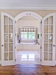 Example of a mid-sized classic master white tile drop-in bathtub design in