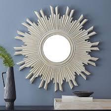 white carved wood sunburst mirror