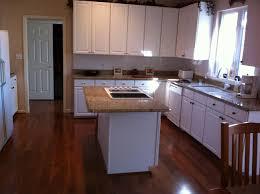 Dark Wood Floors In Kitchen Kitchen White Cabinets Dark Wood Floors The Interior Design Miserv