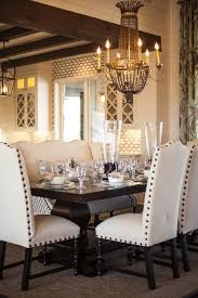 love this dining table with the nailhead chairs diffe fabric for chairs