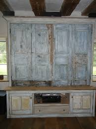 last but not least i had this entertainment center made out of one fireplace door the kind that used to keep the cold and drafty air out of the walk in