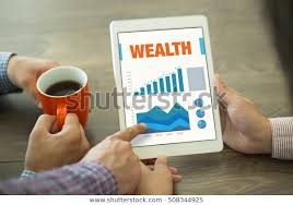 Charting Your Way To Wealth Book Business Charts Graphs On Screen Wealth Stock Photo Edit