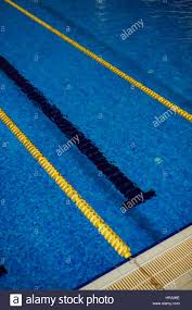 swimming pool lane lines background. High Angle Background Image Of Clear Blue Water In Empty Swimming Pool With Lanes And Lines Lane I
