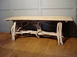 sold a decorative rectangular driftwood table to zoom