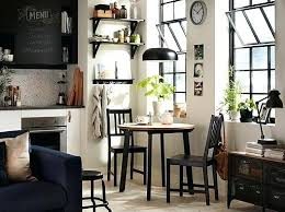 small dining room table black and white kitchen with small round table and two chairs in the corner