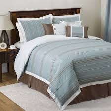 Bedroom. Blue Brown Bed Sheet On The Brown Wooden Bed Combined With Brown  Wooden Side