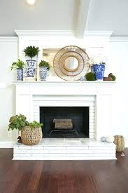 white brick fireplace inspiring for a brighter room design wood mantel gray walls full size