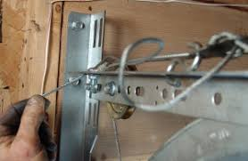 move to the other side of the garage door and repeat this process remove the old stationary pulley