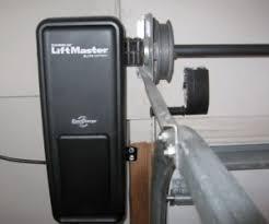 how does a jackshaft garage door opener work