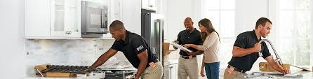 home depot associates working with homeowner on a kitchen remodel project