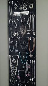 My metal pegboard jewelry organizer behind the door and utilizing a small  wasted space of wall