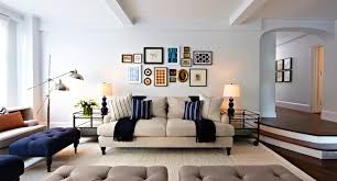 large collage frames living room transitional with silk rug wood living room