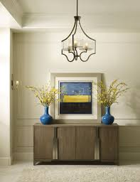 layer your lighting in the entryway to create a warm and inviting space and nice first