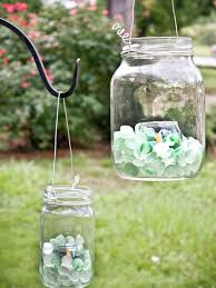 mason jar lanterns i just saw this on the website and thought i would share i am going to make some of these lanterns for my backyard
