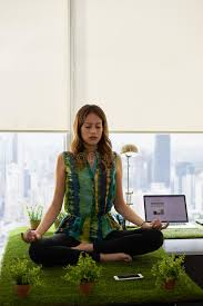 meditation office. download business woman doing yoga meditation on table in office stock photo image 62866810