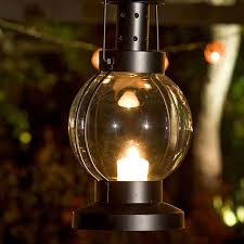 use mini lanterns suspended from plant hangers 225079 to light up the outside corners of a gazebo and illuminate its architecture outdoor lanterns