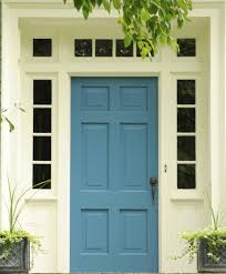 this blue front door has a br key entrance door and a br handle