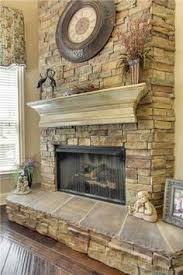 Stack stone fireplace with a distressed mantle