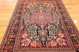 20th century vintage dark background isfahan persian rug for