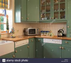 Ceramic Wall Tiles Kitchen Green Fitted Cupboards And White Ceramic Wall Tiles In Cottage