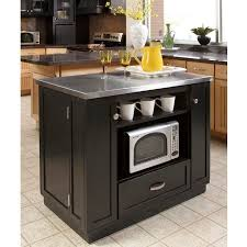 small kitchen island with stainless steel top .