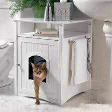 kitty washroom furniture disguises the litter box forget bulky plastic covers this cabinet combines good looks and practicality by hiding the litter box arena kitty litter box