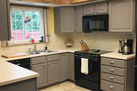 image of grey kitchen cabinets white countertops