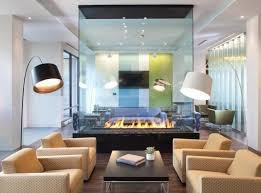 If you want to keep a visual connection between two spaces but still want  to have a fireplace dividing the room, the answer is simple  a double  sided glass ...