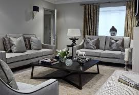fabulous living room in gray with a black coffee table design boscolo interior design