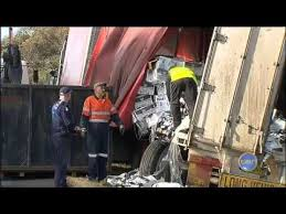 Truck spill causes traffic - YouTube