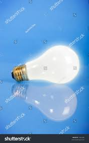 Light Bulb Laying Down Light Bulb On Blue Glowing Standing Stock Photo Edit Now