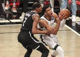 Giannis Antetokounmpo outduels Kevin Durant as Bucks oust Nets