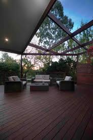 Merbau decking, outdoor settings, decks, pergolas, privacy screens.  Construction by ACT