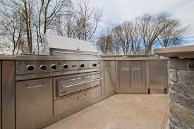 this restaurant grade outdoor kitchen and grill features a working sink stainless steel cabinetry viking grill icemaker refrigerator and warming drawer