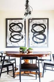 modern dining e with eclectic art a bubble chandelier and a vine table