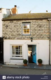house front door open. Clipped Box In Pots On Either Side Of Open Front Door Cornish Coastal Cottage With House