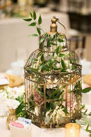 33 Elegant Birdcage Wedding Centerpieces a gilded bird cage with foliage  and pastel florals