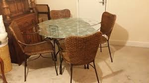 round glass top wicker dining table with 4 chairs