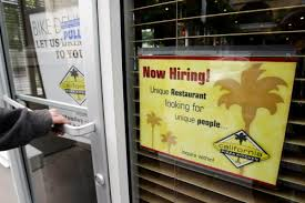 A Customer Opens The Front Door Of A California Pizza Kitchen With A Hiring  Sign In Foreground In Palo Alto, Calif., Wednesday, May 25, 2011.