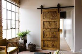 Unique Sliding Doors From Old Barn Wood Hanging On Black Metal Rod ...