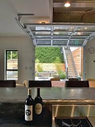kitchen garage door a gl paneled garage door virtually eliminates the division between the main room kitchen garage door