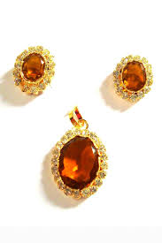 designer brown and golden color copper and stone pendant set from kalaniketan com