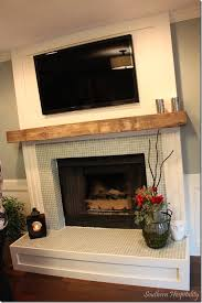 i love the glass tile around fireplace and the wood casing the lettered cottage tv