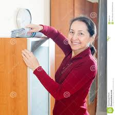 dusting furniture. Happy Mature Woman Dusting Furniture Stock Photo - Image Of Service, Housekeeper: 36084118 L