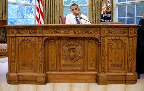 bush oval office. Washington, D.C. · Barack Obama Sitting At The Ornate Resolute Desk In 2009 Bush Oval Office