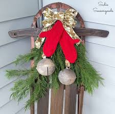 porch decor with a vintage wooden sled and repurposed sweater mittens