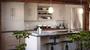 neutral kitchen design with white kitchen cabinet and grey tile backsplash also stylish black kitchen stool decorating idea