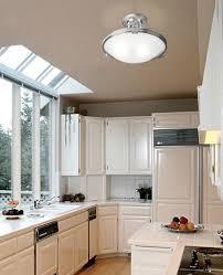 semi flushmount light fixture in a light filled kitchen